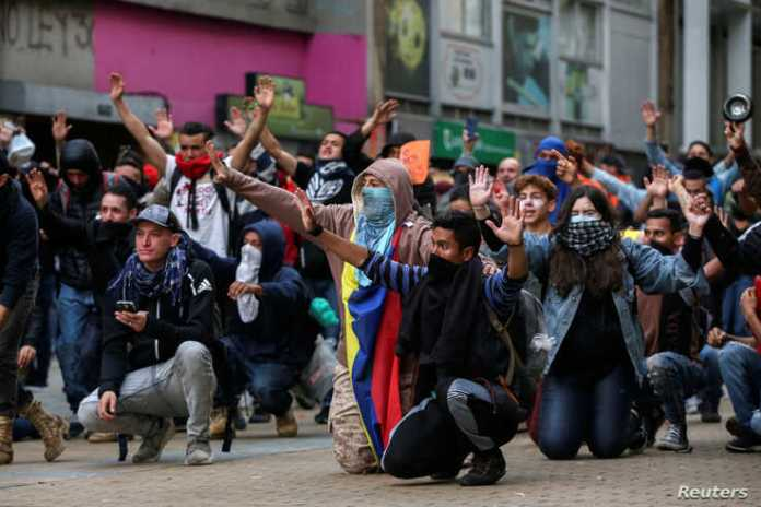 Demonstrators gesture during a protest on the second day of a national strike, in Bogota, Colombia, November 22, 2019. REUTERS