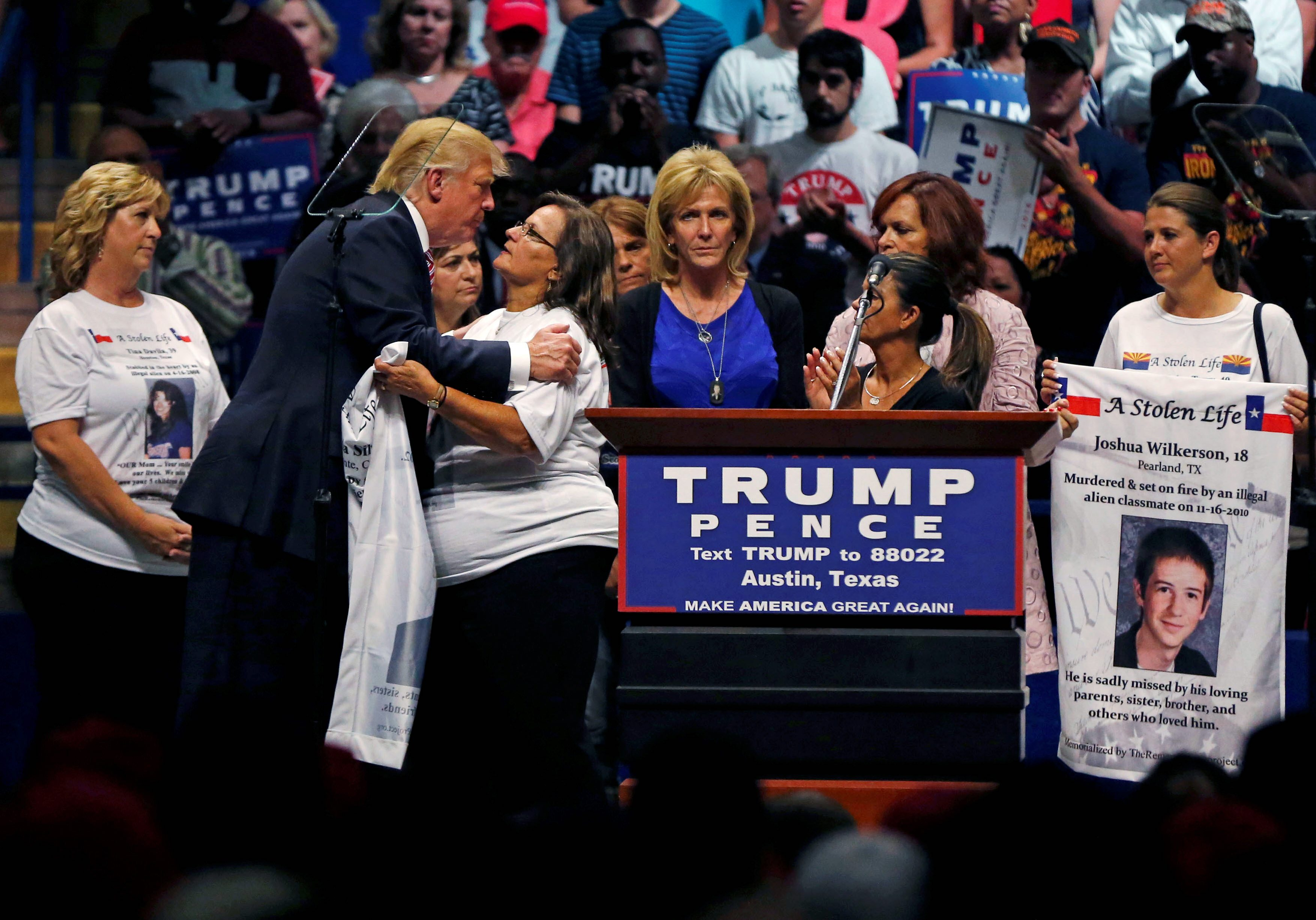 Image result for photo of trump with families harmed by immigration