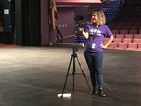 Director of Education and Community Engagement, Kelli Maldonado, stands on the Van Wezel stage while live-streaming a backstage tour to a virtual classroom of local students.