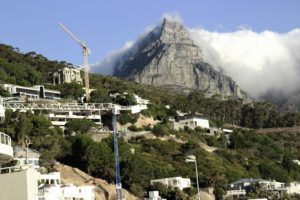 The imposing stature of Table Mountain as the bus passes through Camps Bay.