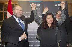 NDP leader Thomas Mulcair raises the hand of Maria Mourani in Montreal, Wednesday, January 21, 2015, where he announced that she would run as an NDP candidate in the riding of Ahuntsic-Cartierville in the upcoming federal election. THE CANADIAN PRESS/Graham Hughes