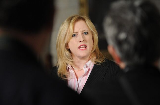 Federal Labour Minister Lisa Raitt delivers a statement in the foyer of the House of Commons on Parliament Hill in Ottawa on Tuesday, March 13, 2012. THE CANADIAN PRESS/Sean Kilpatrick