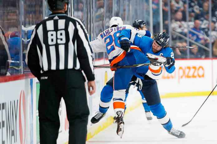 Blake Wheeler of Winnipeg Jets fights in the second period against Oliver Wahlstrom of New York Islanders.