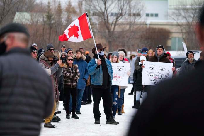 Many speakers spread conspiracy theories and espoused anti-vaccine views at the rally.  (Daniel Crump / Winnipeg Free Press) </ p data-recalc-dims =