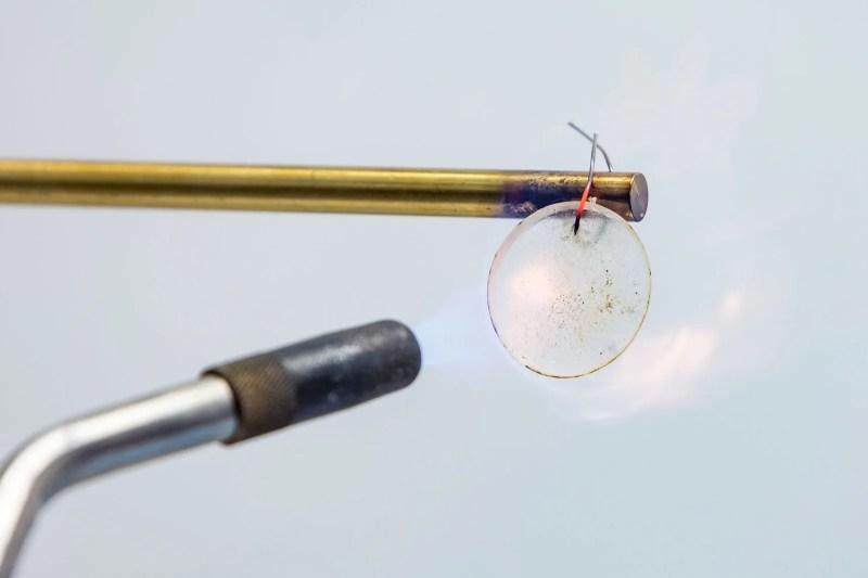 a torch blowing a lithium gel
