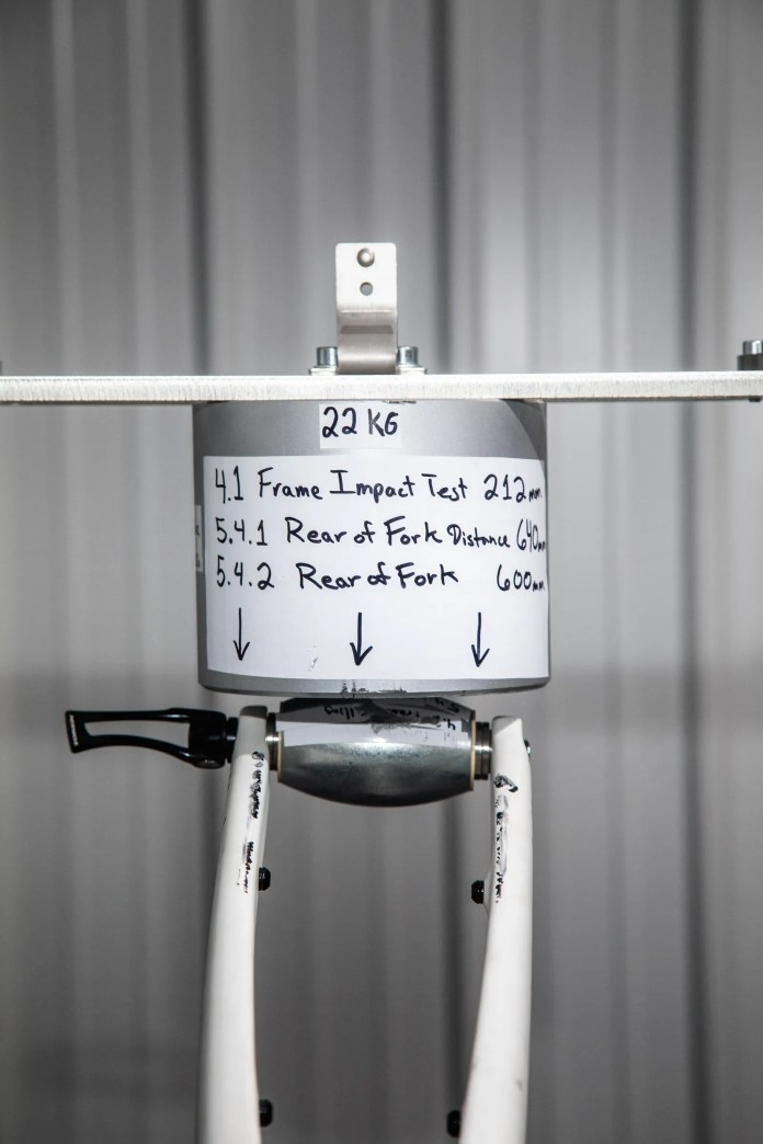 Part of an instrument that performs a bike frame impact test
