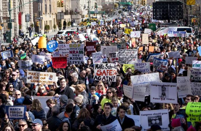 People take part in a march rally against gun violence Saturday, March 24, 2018, in New York