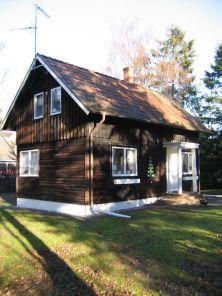 Gediget bygge i form av ett blockhus uppfört i Höllviken 1930.