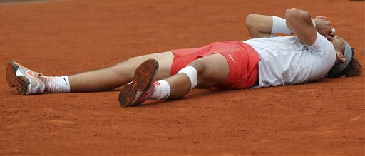 Spain's Rafael Nadal reacts as he defeats compatriot David Ferrer during the men's final match of the French Open tennis tournament at the Roland Garros stadium Sunday, June 9, 2013 in Paris. Nadal won 6-3, 6-2, 6-3