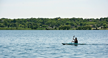A kayaker paddles along the Kempenfelt Bay shore near Heritage Park in Barrie.