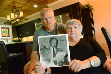 Trevor McKean and his mother Ann Gage hold a picture of Sgt. Ron McKean, who was killed in the line of duty on Oct. 12, 1977.