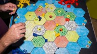Spielerisch lernen: Die Siedler von Catan erklären einiges über Handel.