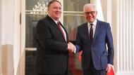 Polens Außenminister Jacek Czaputowicz und Amerikas Außenminister Mike Pompeo während einer Pressekonferenz am 12. Februar in Warschau.