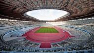 Bauwirtschaftlicher Neonationalismus, anheimelnd und bescheiden präsentiert: das Rund des neuen Stadions in Tokio