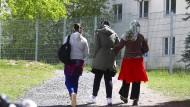Asylbewerberinnen auf dem Gelände der Erstaufnahmeeinrichtung des Landes Thüringen in Suhl, 2020