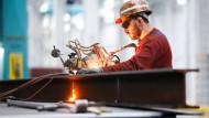 Der Bau und der Konsum sorgen für eine steigende deutsche Wirtschaftsleistung.