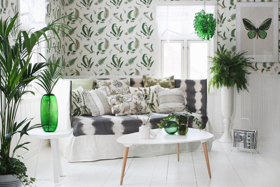 https www living4media com images 11304300 50s style coffee table in front of sofa with high backrest in rustic interior with decorative foliage plants