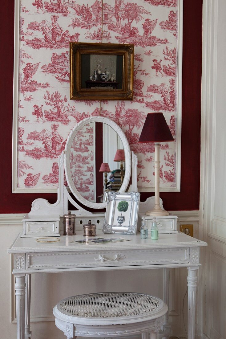 https www living4media com images 11350838 dressing table against red and white toile de jouy wallpaper in bedroom