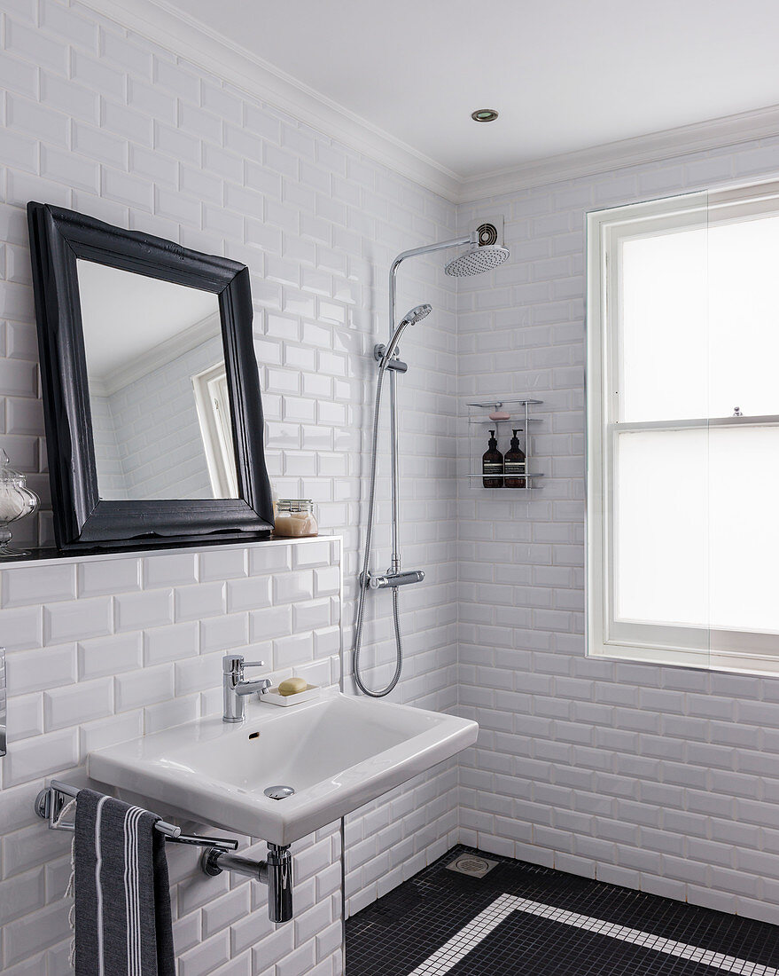 https www living4media ae images 12607668 classic black and white bathroom with subway wall tiles and mosaic floor