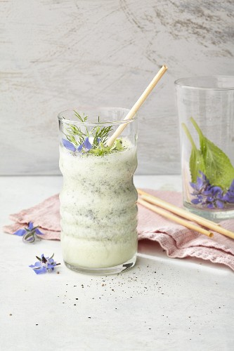 Cucumber drink with almond milk, limes, dill and borage flowers