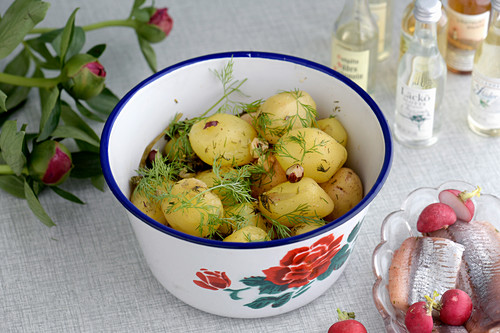 Fresh Potatoes with broth of pickled herring