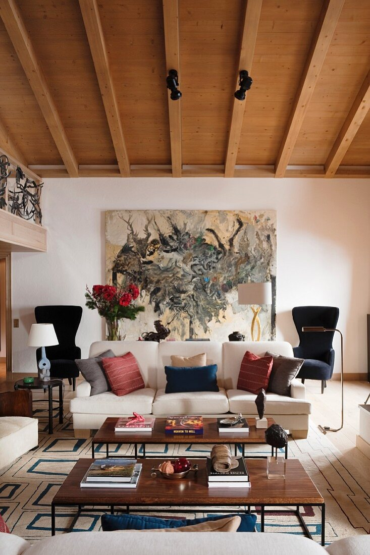 https www living4media com images 11140079 60s style coffee tables and various scatter cushions on sofa in living room with wood beamed ceiling