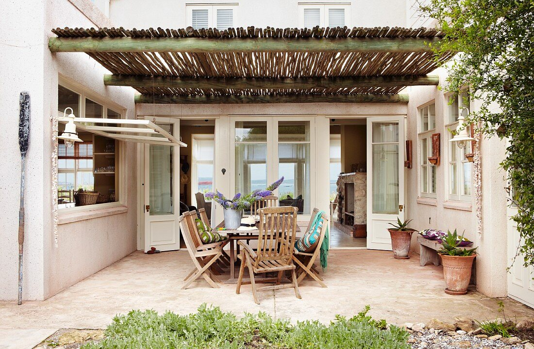 http usa living4media com images 11262781 seating area in patio style courtyard under pergola with bamboo roof covering