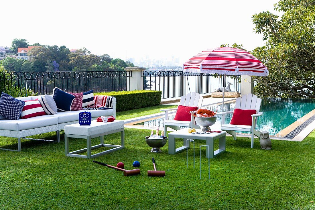 https www living4media com images 11286505 white outdoor furniture with red white and blue accessories in front of pool croquet set in foreground on lawn