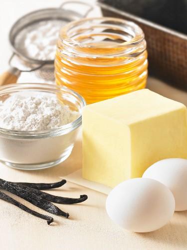 Various baking ingredients (vanilla pods, eggs, butter, flour, honey)
