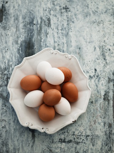 Brown and white eggs on a ceramic plate