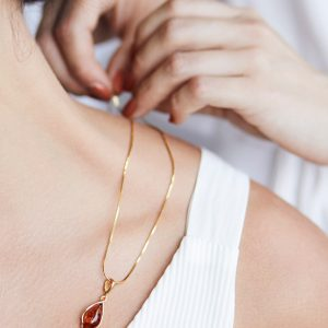Gold-plated necklace with cognac Baltic amber