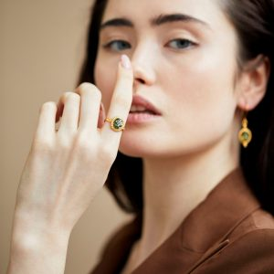 Gold plated ring with green baltic amber