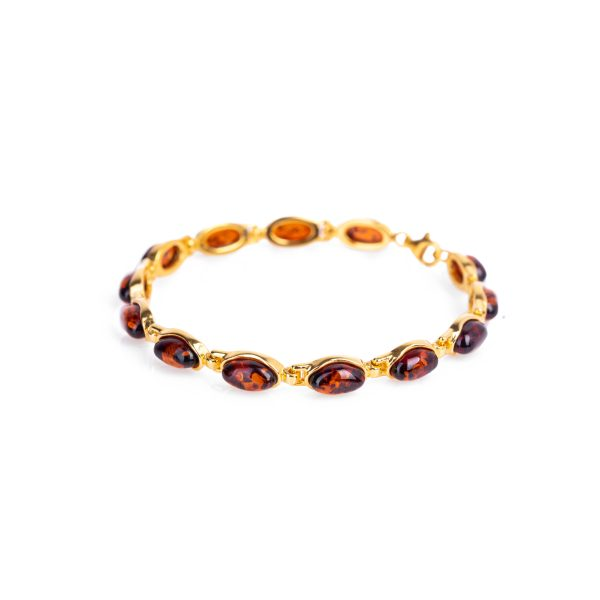 Gold bracelet with cognac amber