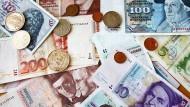 Noch nicht ausgestorben: D-Mark-Geldscheine und Münzen