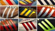 Die Bildkombo zeigt das Markenzeichen des Sportartikelherstellers Adidas in verschiedenen Ausführungen.