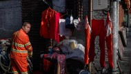 Ein Müllwerker in Peking