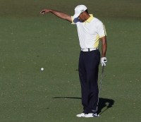 A crime in action: Tiger Woods drops his ball illegally on the 15th hole at Augusta National.