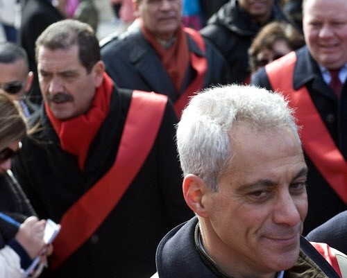 Chuy Garcia pictured not too far behind Rahm Emanuel.