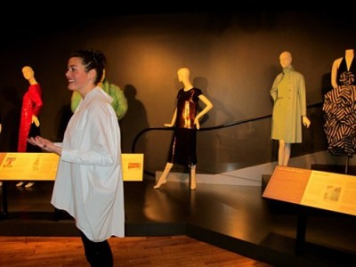 Costume curator Petra Slinkard gives a tour during the social media day