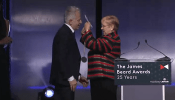 Donnie Madia accepting his Outstanding Restaurateur award from Lidia Bastianich