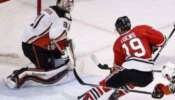 Jonathan Toews gets blocked by a duck.