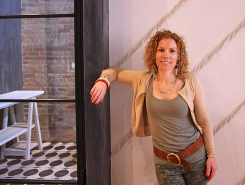 Karen Herold in the entry of Studio K, which serves to show some of the textures she likes to use in her restaurant projects.