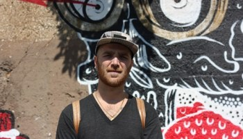 Nick Marzullo, co-owner of the artists collective Pawn Works, wonders when its going to get paid for work on murals in Pilsen.