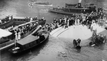 Passengers wait for help after the Eastland capsized in the Chicago River on July 24, 1915. More than 800 others didnt make it out alive.