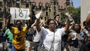 Protesters in Saint Louis call for reforms after police shot and killed Michael Brown and, ten days later, Kajieme Powell.