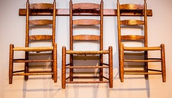 Shaker chairs on pegs