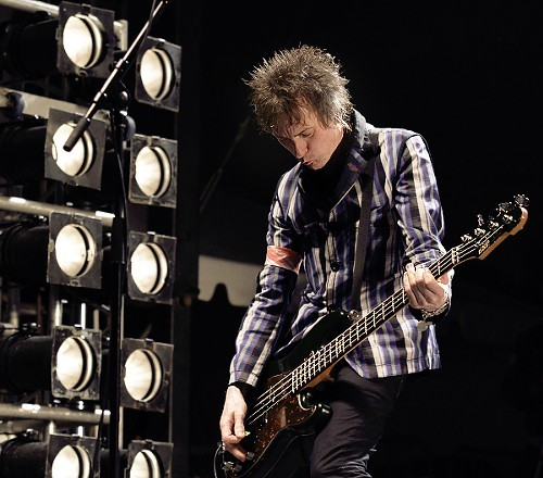 Tommy Stinson of the Replacements digs into his bass.