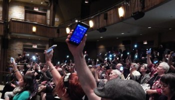 At the Russ Tutterow memorial, a cell phone tribute