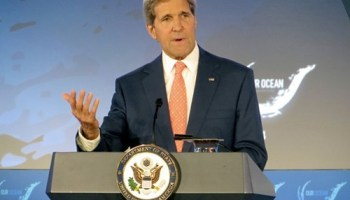 U.S. Secretary of State John Kerry suggested that the United States is talking with Iran about the latest insurgency in Iraq.