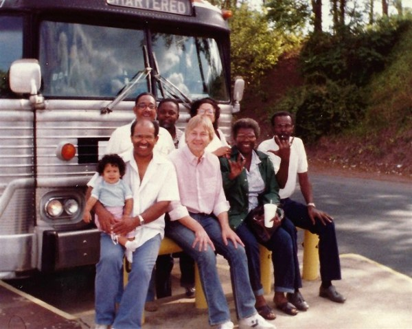 Williams, holding his daughter Carla, and next to Plain Dealer reporter Joe Frolik, on the way to the 1983 National Black Deaf Advocates conference in Philadelphia, PA.